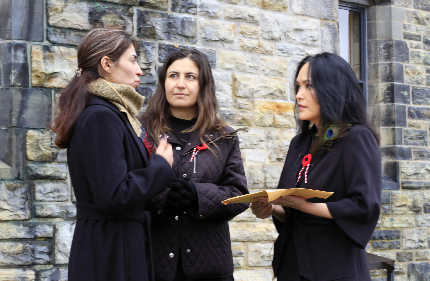 Adiba delivering petition for Yazidi trauma care to Jenny Kwan MP outside of Parliament. Dilkhaz is in the centre providing translation from Kurmanji to English and back.